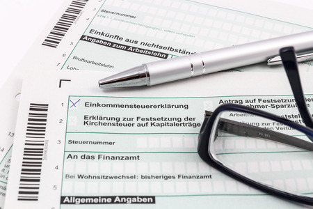 ball pen: Form of income tax return with ball pen and glasses Stock Photo