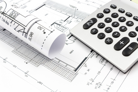 real estate planning: Architectural drawings of a house with calculator