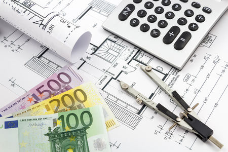 Architectural drawings of a house with euro banknotes, compass and calculator