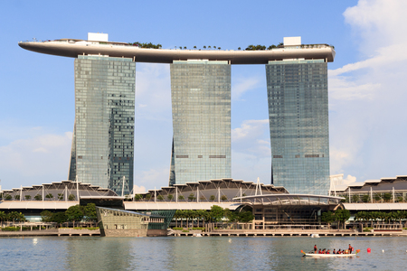 rowing boat: Marina Bay Sands hotel and rowing boat, Singapore Editorial
