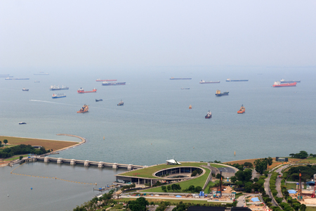 Marina Barrage dam and cargo ships lying in the roads off the coast of Singapore 新闻类图片