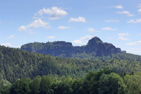 saxon: Group of rocks Schrammsteine and Falkenstein and blue sky in Saxon Switzerland