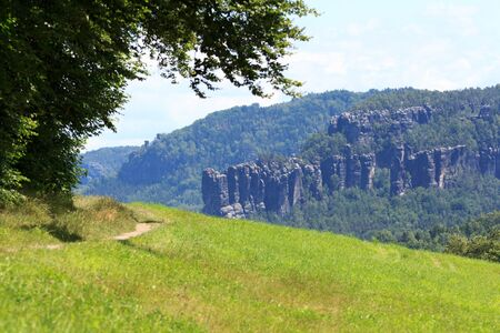 hiking path: Hiking path and group of rocks Affensteine in Saxon Switzerland Stock Photo