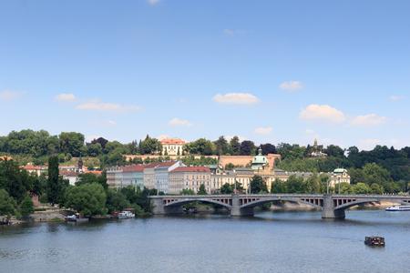 manes: Manes Bridge and boats on river Vltava in Prague
