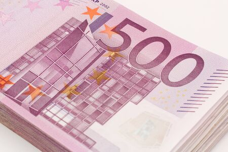 investment banking: Money - Isolated stack of Five hundred 500 euro bills banknotes with white background Stock Photo