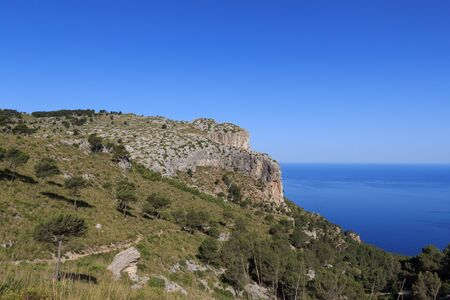 hiking path: Hiking path in Majorca Tramuntana with Mediterranean Sea in background Stock Photo