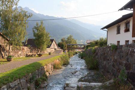 Stream Bretterwandbach with bridge in Matrei in Osttirol, Austria Stock Photo