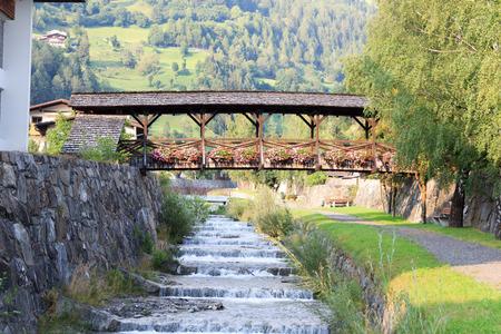 osttirol: Stream Bretterwandbach with bridge in Matrei in Osttirol, Austria Stock Photo