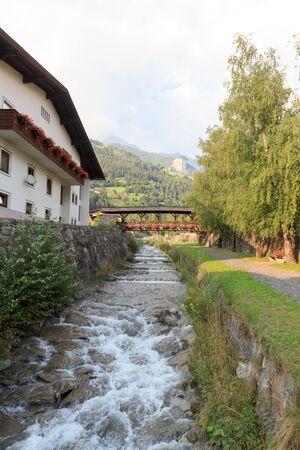 matrei: Stream Bretterwandbach with bridge in Matrei in Osttirol, Austria Stock Photo