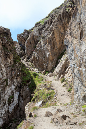steel cable: Steel cable from a via ferrata and mountain footpath, Hohe Tauern Alps, Austria Stock Photo