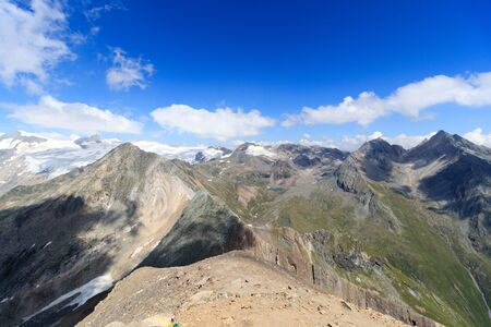 hohe tauern: Panorama with lake Eissee, mountain Weissspitze and glacier Grossvenediger in the Hohe Tauern Alps, Austria Stock Photo