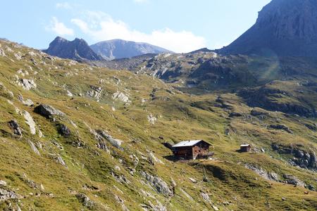 alpine hut: Alpine hut Eisseehutte and mountain panorama in Hohe Tauern Alps, Austria Stock Photo