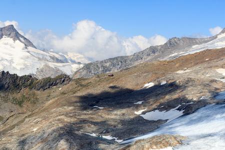 alpine hut: Alpine hut Defreggerhaus at Grossvenediger glacier and mountain panorama in the Hohe Tauern Alps, Austria Stock Photo