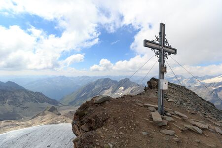 hohe tauern: Summit cross on mountain Weissspitze with panorama in Hohe Tauern Alps, Austria
