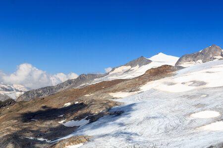 alpine hut: Mountain glacier panorama with summit Grossvenediger south face and alpine hut Defreggerhaus in the Hohe Tauern Alps, Austria Stock Photo