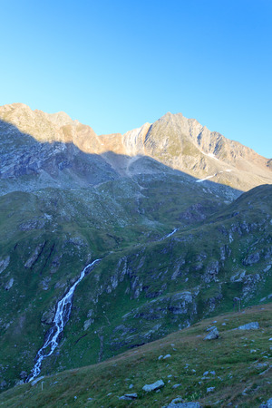 hohe tauern: Mountain Zopetspitze and alpine stream at sunrise in Hohe Tauern Alps, Austria Stock Photo