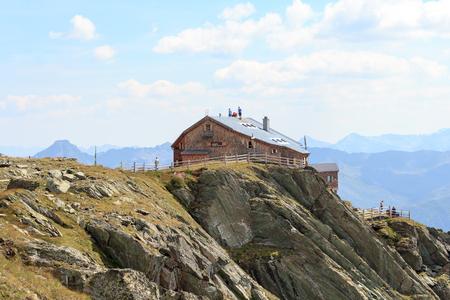 alpine hut: Craftsmen standing on the roof of alpine hut Bonn Matreier Hutte in Hohe Tauern alps, Austria