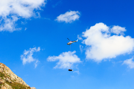 rescue helicopter: Rescue helicopter and mountain in Hohe Tauern Alps, Austria Stock Photo