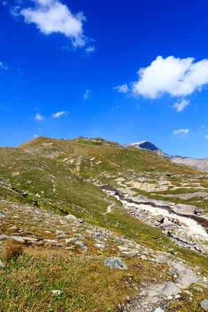alpine hut: Alpine hut Badener Hutte, mountain Kristallwand and rapid stream in Hohe Tauern Alps, Austria Stock Photo