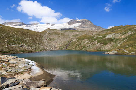 hohe tauern: Lake and glacier panorama with mountain Kristallwand in Hohe Tauern Alps, Austria Stock Photo