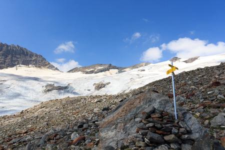 hohe tauern: Signpost and mountain glacier panorama in Hohe Tauern Alps, Austria Stock Photo