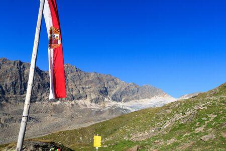 hohe tauern: Mountain panorama with Austrian flag in Hohe Tauern Alps, Austria