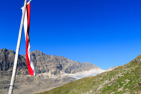 tauern: Mountain panorama with Austrian flag in Hohe Tauern Alps, Austria