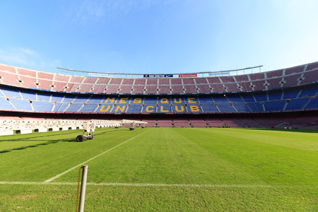 interior lighting: Football stadium Camp Nou interior with grass field, grow lighting and stands in Barcelona
