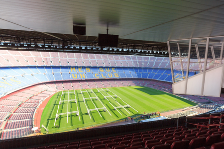 commentators: Football stadium Camp Nou interior panorama with grass field, stands and commentators boxes in Barcelona