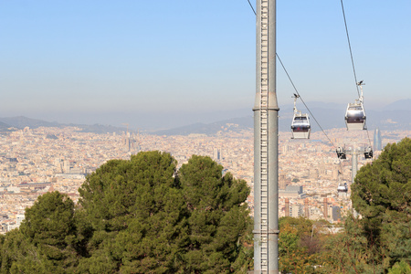 montjuic: Aerial gondola lift with cable car and Barcelona cityscape panorama seen from Montjuic, Spain Stock Photo