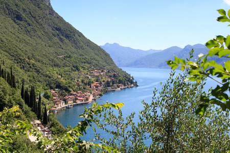 Panorama of lakeside village Fiumelatte at Lake Como with mountains in Lombardy, Italy