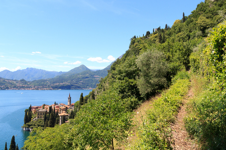 path to romance: Hiking path and panorama of lakeside village Varenna at Lake Como with mountains in Lombardy, Italy