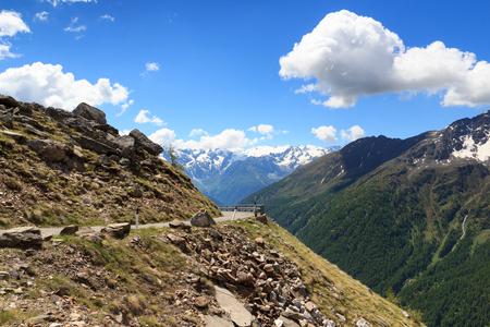 gavia: Gavia pass road with panorama view alpine mountains Adamello Alps, Italy Stock Photo