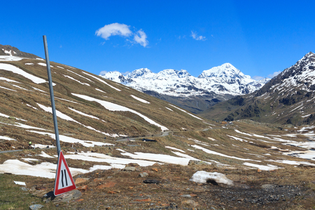 gavia: Gavia pass road with panorama view and alpine mountains Gran Zebru and Ortler, Italy