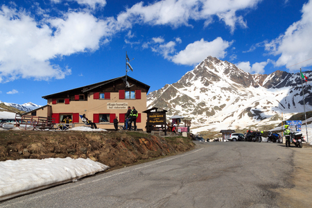 Alpine hut Rifugio Bonetta at gavia pass and mountain Corno dei Tre Signori, Italy