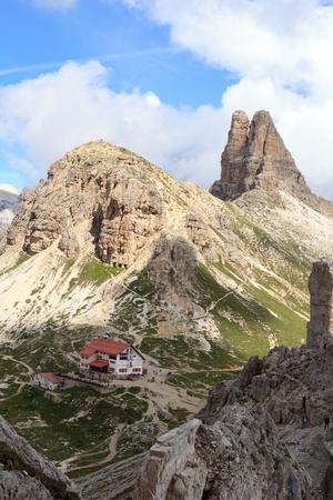 Sexten Dolomites panorama with alpine hut Dreizinnenhutte, rock Frankfurter Wurstel and mountain Toblinger Knoten in South Tyrol, Italy Stock Photo