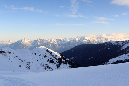 Mountain panorama with snow and snowshoe trail in winter in Stubai Alps, Austria Stock Photo