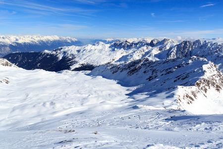 Mountain panorama with snow and ski tracks in winter in Stubai Alps, Austria Stock Photo