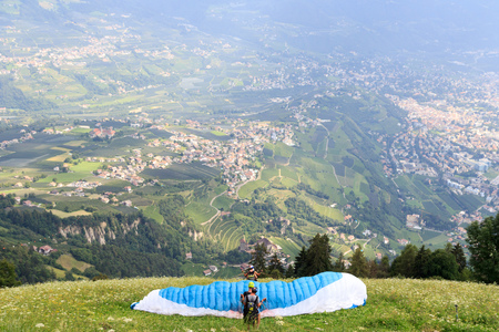Paragliders start Paragliding in front of Merano panaroma in South Tyrol Stock Photo