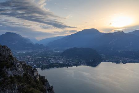 Riva del Garda town panorama at Lake Garda and mountains at sunrise in the morning, Italy Stock Photo