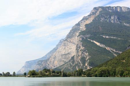 Castle Castel Toblino at lake Lago di Toblino and mountain panorama in Italy