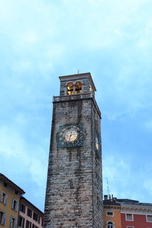 Medieval Torre Apponale tower in Riva del Garda in the evening, Italy Stock Photo