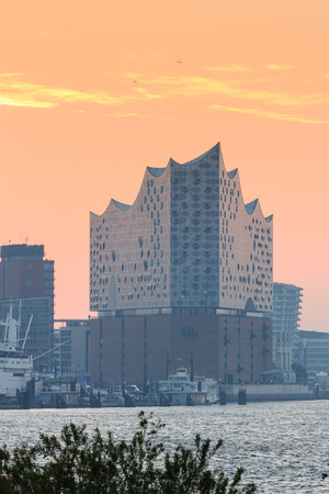 Elbe Philharmonic Hall (Elbphilharmonie) and River Elbe panorama in autumn at morning with sunrise in Hamburg, Germany