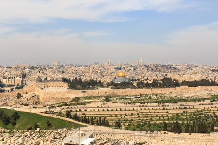 Mount of Olives Jewish Cemetery and Jerusalem Old city cityscape panorama with Dome of the Rock with gold leaf and Al-Aqsa Mosque on Temple Mount and Rotunda of Church of the Holy Sepulchre, Israel