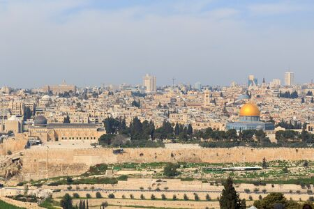Jerusalem Old city cityscape panorama with Dome of the Rock with gold leaf and Al-Aqsa Mosque on Temple Mount and Rotunda of Church of the Holy Sepulchre, Israel