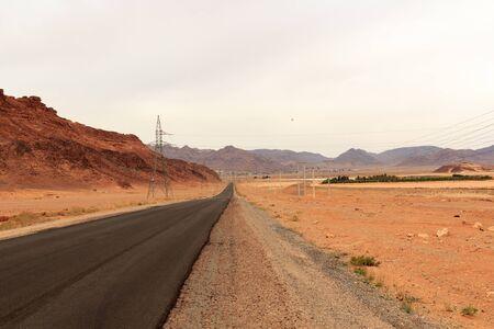 Street to desert Wadi Rum and mountain panorama, Jordan
