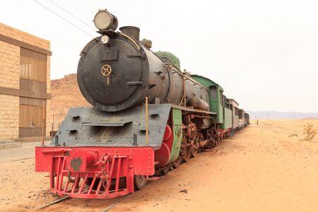 Steam locomotive and train wagons at Hejaz railway station near Wadi Rum, Jordan