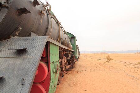 Steam locomotive and train wagons at Hejaz railway station near Wadi Rum, Jordan Banco de Imagens
