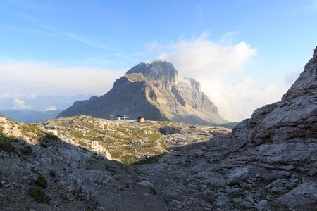 Mountain Pietra Grande in Brenta Dolomites with clouds, Italy