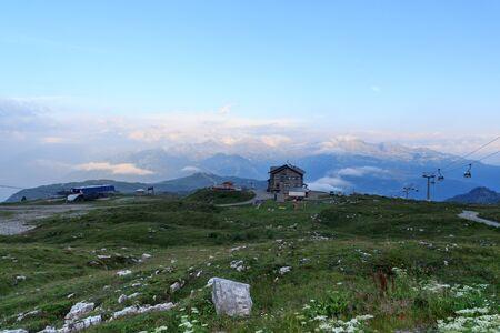 Mountain alps panorama of Adamello-Presanella Alps, Groste Express cable car and alpine hut Rifugio Graffer seen from Brenta Dolomites in Italy Stock Photo